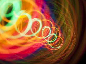 a shelter-skelter spiral of colorful light trails